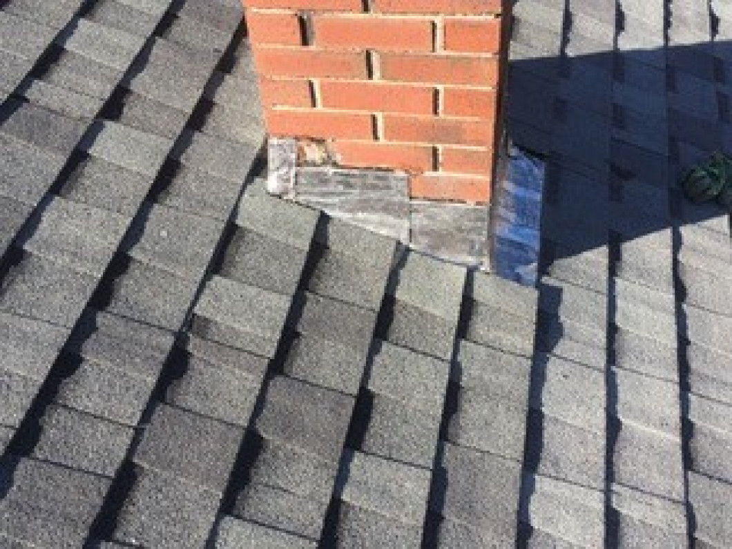 What makes asphalt an ideal roofing material?